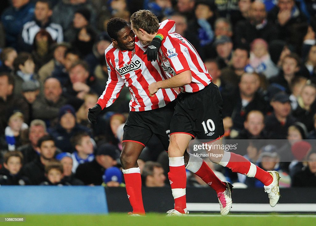Asamoah Gyan of Sunderland (L) celebrates with Jordan Henderson as he scores their second goal during the Barclays Premier League match between Chelsea and Sunderland at Stamford Bridge on November 14, 2010 in London, England.