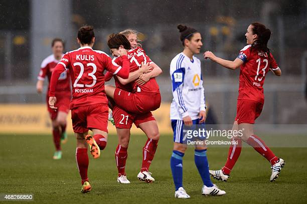 Asano Nagasato of Turbine Potsdam celebrates as she scores the opening goal during the Women's DFB Cup Semi Final match between 1 FFC Frankfurt and...
