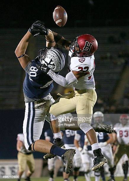 Asante Gibson of the Harvard Crimson breaks up a pass intended for Leo Haenni of the Yale Bulldogs in the second half on November 21 2015 in New...