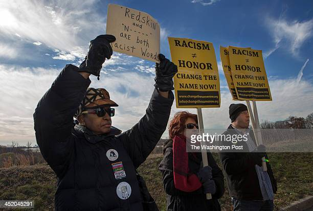 Asantewaa NkrumahTure Melba Conway and Jon Miller protest the name of the Washington Redskins in the shadow of FedEx Field along with leaders from...