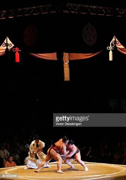 Asashoryu and Kisenosato vie for leverage after their initial charge at one another to start their the Grand Championship match during the 2008 Grand...