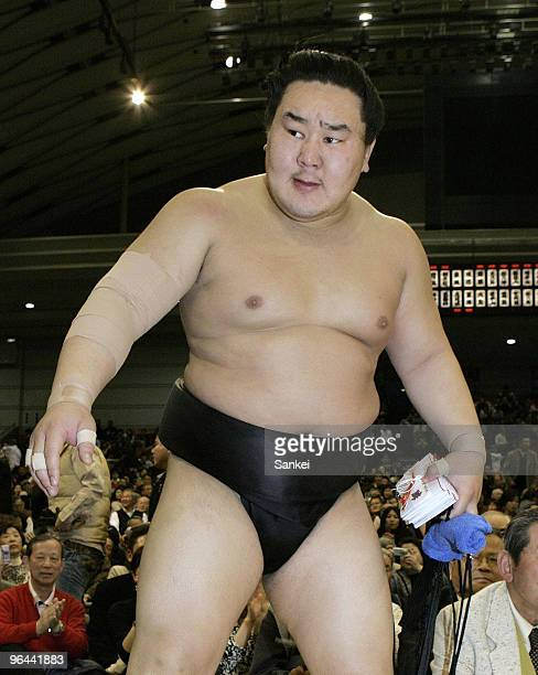Asashoryu reacts after beating Kotomitsuki on the day ten of the Grans Sumo Spring Tournament at Osaka Prefecture Gymnasium on March 20 2007 in Osaka...