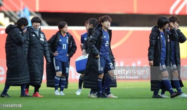 Asato Miyagawa of Japan and team mates look on after the Women's International Friendly between Germany and Japan at Benteler Arena on April 09 2019...