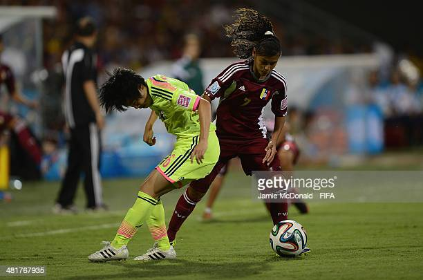 Asato Miyagawa of Japan battles with Yosneidy Zambrano of Venezuela during the FIFA U17 Women's World Cup Semi Final match between Venezuela and...