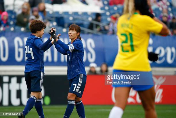 Asato Miyagawa of Japan congratulates teammate Emi Nakajima after a goal against Brazil during the first half of the 2019 SheBelieves Cup match...