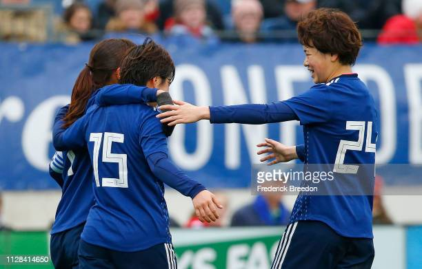 Asato Miyagawa of Japan congratulates teammate Uuka Momiki on scoring a goal against Brazil during the first half of the 2019 SheBelieves Cup match...