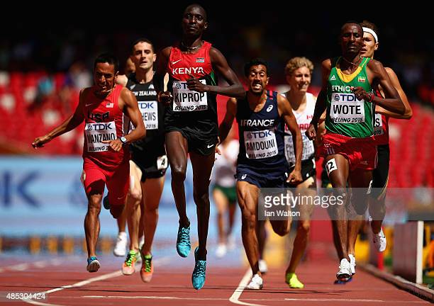 Asbel Kiprop of Kenya and Aman Wote of Ethiopia cross the finish line in the Men's 1500 metres heats during day six of the 15th IAAF World Athletics...