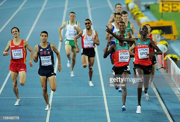 Asbel Kiprop of Kenya celebrates victory ahead of Silas Kiplagat of Kenya and Matthew Centrowitz of the USA in the men's 1500 metres final during day...
