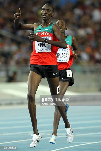 Asbel Kiprop of Kenya celebrates victory ahead of Silas Kiplagat of Kenya in the men's 1500 metres final during day eight of 13th IAAF World...