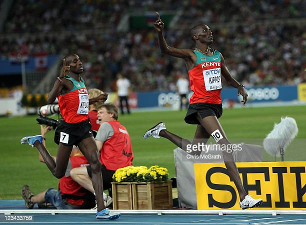 Asbel Kiprop of Kenya claims victory ahead of Silas Kiplagat of Kenya in the men's 1500 metres final during day eight of 13th IAAF World Athletics...