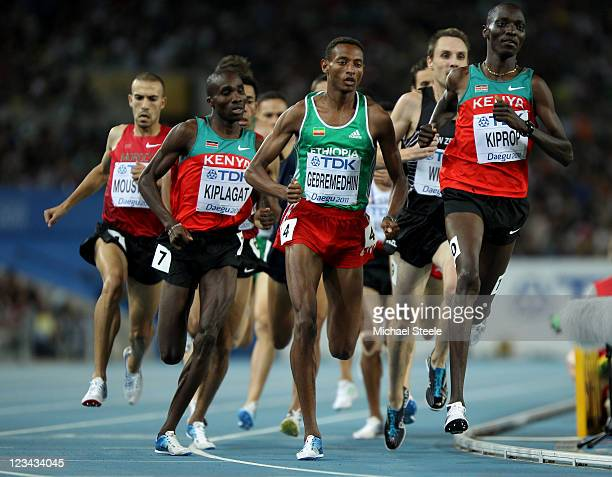 Asbel Kiprop of Kenya competes with Silas Kiplagat of Kenya and Mekonnen Gebremedhin of Ethiopia in the men's 1500 metres final during day eight of...
