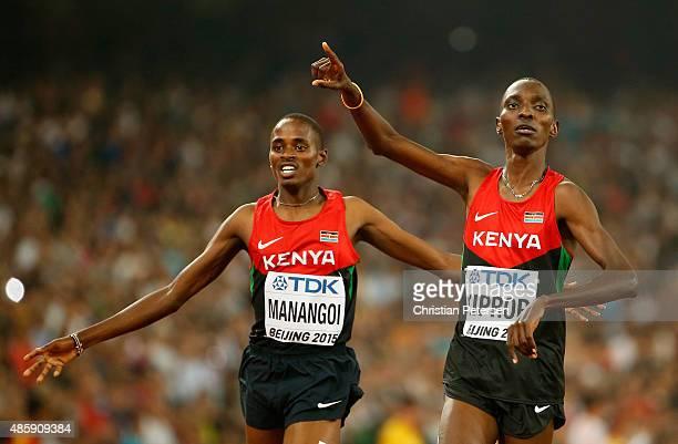 Asbel Kiprop of Kenya crosses the finish line to win gold in the Men's 1500 metres final ahead of Elijah Motonei Manangoi of Kenya during day nine of...