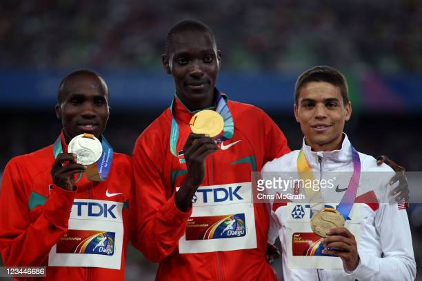 Asbel Kiprop of Kenya poses with his gold medal, Silas Kiplagat of Kenya the silver and Matthew Centrowitz of the USA the bronze during the medal...