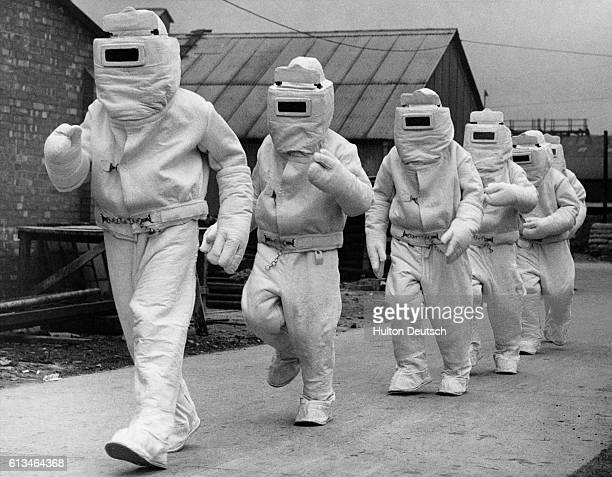 Asbestos fire fighting suits intended for use by the air arm of the Royal Navy are modeled at the factory where they are made UK October 14 1940