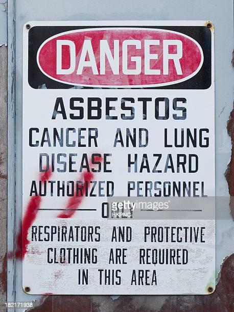 Asbestos Sign On Door With Graffiti