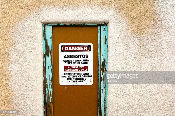 Asbestos Warning Sign on Condemned Property Door