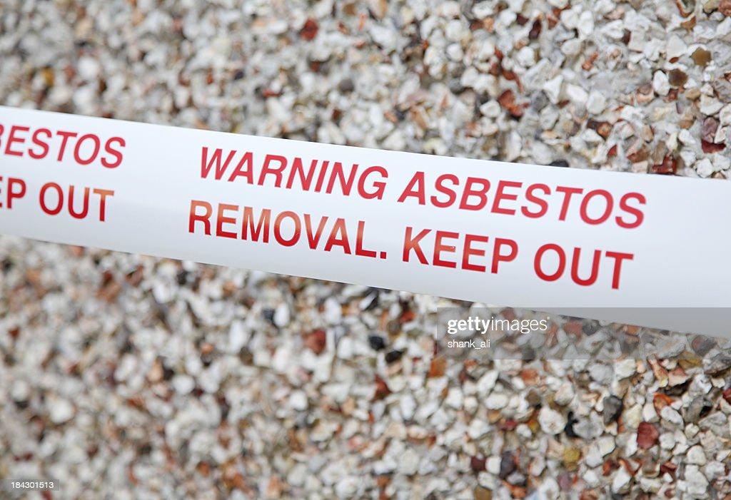 asbestos warning tape : Stock Photo
