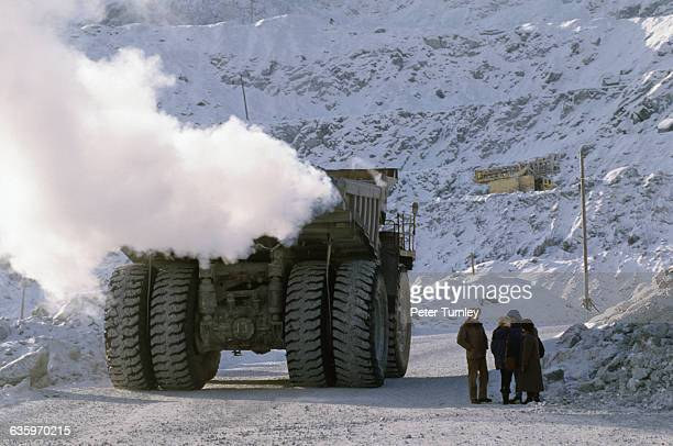 Asbestos Workers near Heavy Machinery