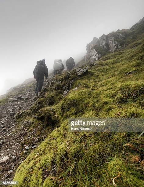 ascending into the clouds. - mount snowdon stock pictures, royalty-free photos & images