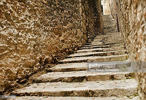 Ascending medieval stone staircase