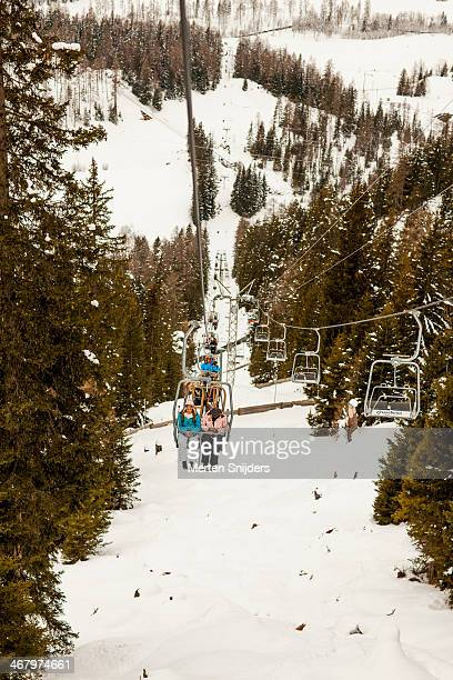 ascending ski lift with passengers - merten snijders stock pictures, royalty-free photos & images