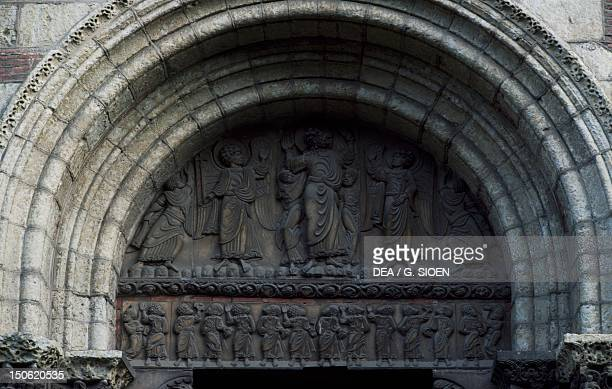 Ascension of Jesus and the twelve Apostles tympanum decorated in relief from above the Miegeville door Basilica of St Sernin Toulouse MidiPyrenees...