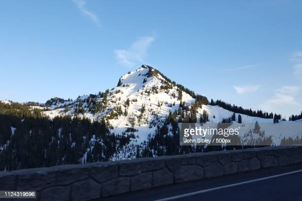 ascent top of chinook pass mtn scene heading home from waverly - sibley stock photos and pictures
