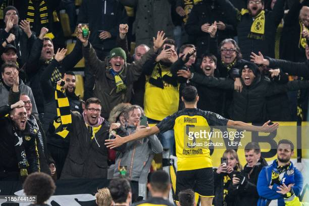 Aschraf Hakimi of Dortmund celebrates his team's third goal with his team mates during the UEFA Champions League group F match between Borussia...