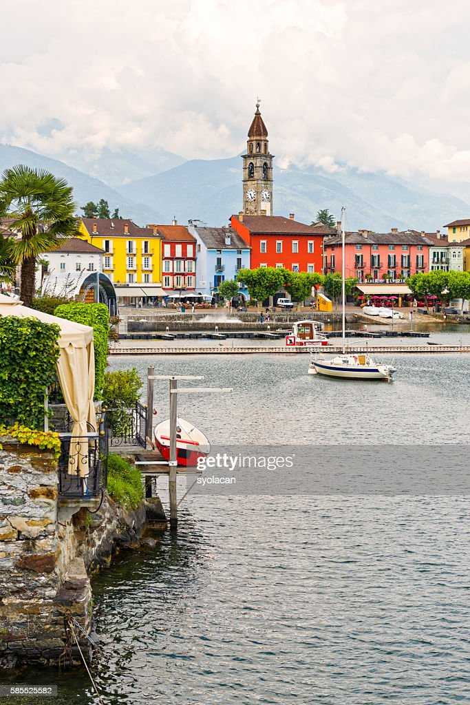 Ascona, old town houses with clock tower : Stock Photo