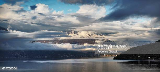 ascona on lake maggiore with dramatic clouds after autumnal rain, ticino, southern switzerland - ascona stock photos and pictures