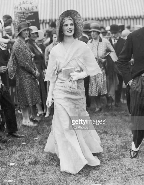 Ascot dress with matching cape. A straw hat has a cloche shaped crown with a halo brim.