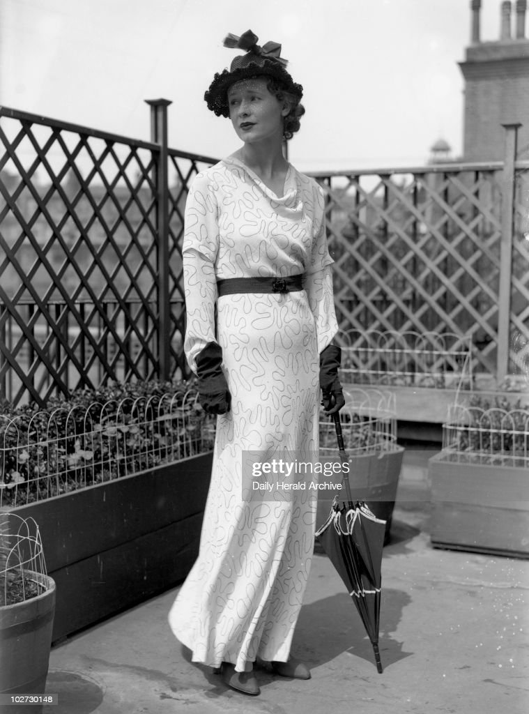 Ascot Fashions by Schiaparelli, 13 June 193 Ascot Fashions by Schiaparelli, 13 June 1934. Elsa Schiaparelli (1890-1973), a French fashion designer whose designs were inventive and sensational, she was noted for her sense of colour including 'shocking pink', and her original use of traditional fabrics. Schiaparelli featured zips and buttons and made outrageous hats. Photograph by James Jarche (1891-1965).