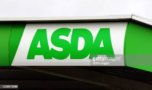 Asda logo seen above one of their petrol stations next to a supermarket UK's third biggest supermarket chain Asda has been sold by its US owner...