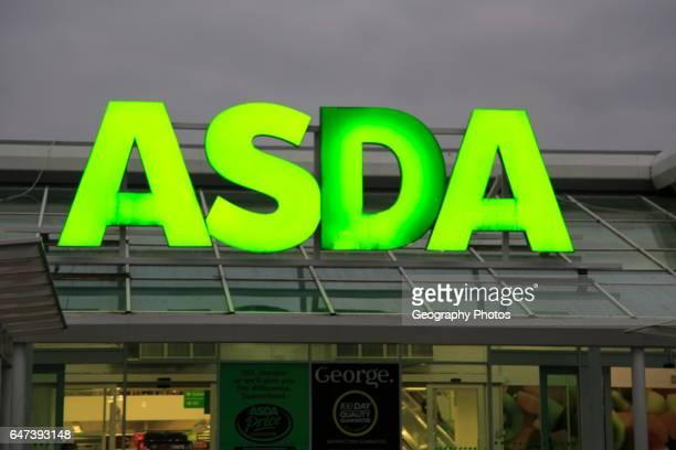 Asda superstore sign lit up at night Falmouth Cornwall UK