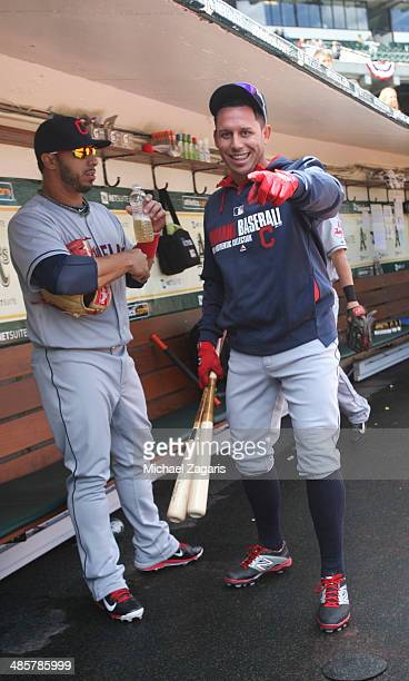 Asdrubal Cabrera and Mike Aviles of the Cleveland Indians stand in the dugout prior to the game against the Oakland Athletics at Oco Coliseum on...