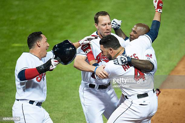 Asdrubal Cabrera David Murphy and Nyjer Morgan celebrate with Mike Aviles of the Cleveland Indians after Aviles hit a walkoff single to center to...