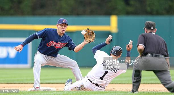 Asdrubal Cabrera of the Cleveland Indians gets ready to put the tag on Jose Iglesias of the Detroit Tigers at second base during the eighth inning of...