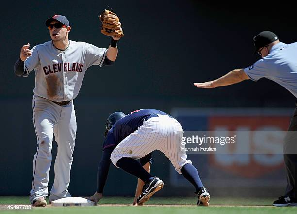 Asdrubal Cabrera of the Cleveland Indians reacts as umpire Jeff Nelson calls Brian Dozier of the Minnesota Twins safe at second base with a stolen...
