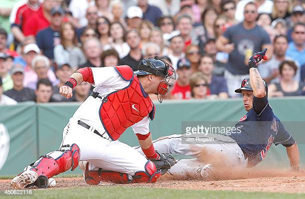 Asdrubal Cabrera of the Cleveland Indians slides safely home as AJ Pierzynski of the Boston Red Sox tags him without the ball in his glove in the 7th...