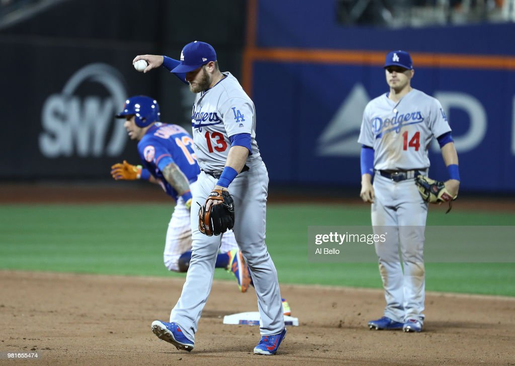 Asdrubal Cabrera #13 of the New York Mets advances to third base on a throwing error by Max Muncy #13 of the Los Angeles Dodgers in the eigth inning during their game at Citi Field on June 22, 2018 in New York City.