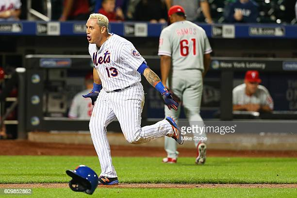 Asdrubal Cabrera of the New York Mets celebrates after hitting a game winning walkoff three run home run in the bottom of the twelfth inning against...