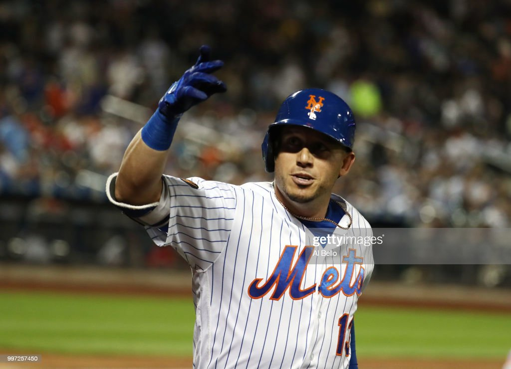 Asdrubal Cabrera #13 of the New York Mets celebrates his eigth inning home run against the Washington Nationals during their game at Citi Field on July 12, 2018 in New York City.