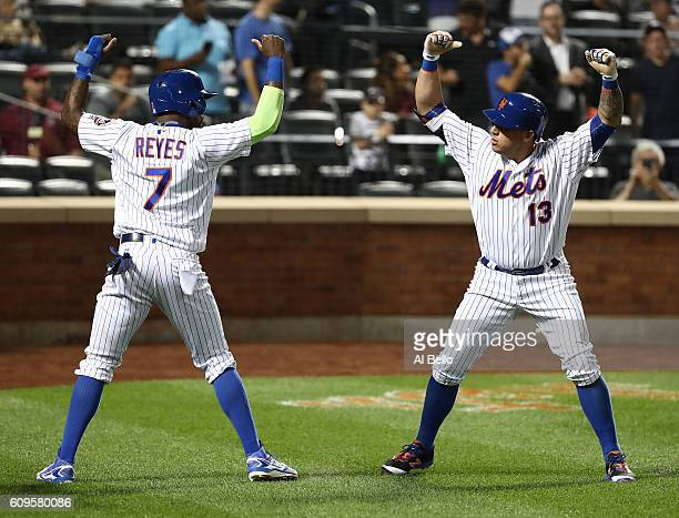 Asdrubal Cabrera of the New York Mets celebrates his two run home run against the Atlanta Braves with Jose Reyes of the New York Mets in the first...