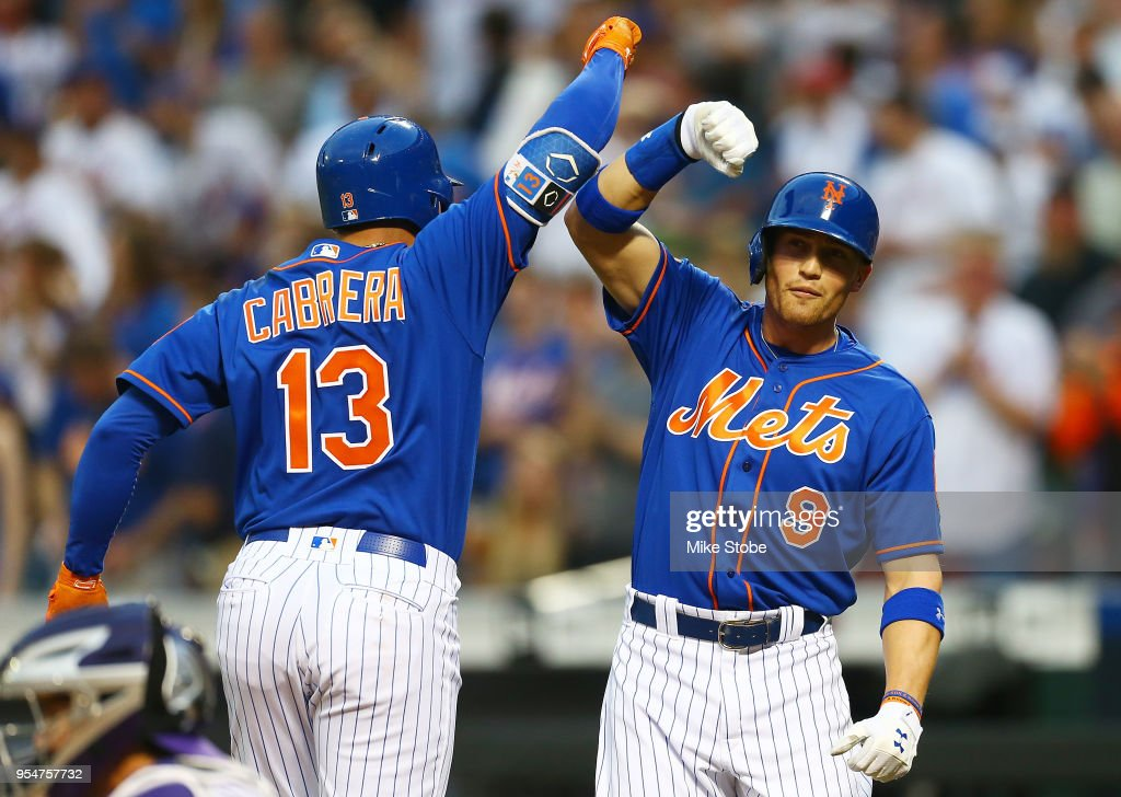 Asdrubal Cabrera #13 of the New York Mets celebrates with Brandon Nimmo #9 after hitting a two-run home run in the first inning against the Colorado Rockies at Citi Field on May 4, 2018 in the Flushing neighborhood of the Queens borough of New York City.