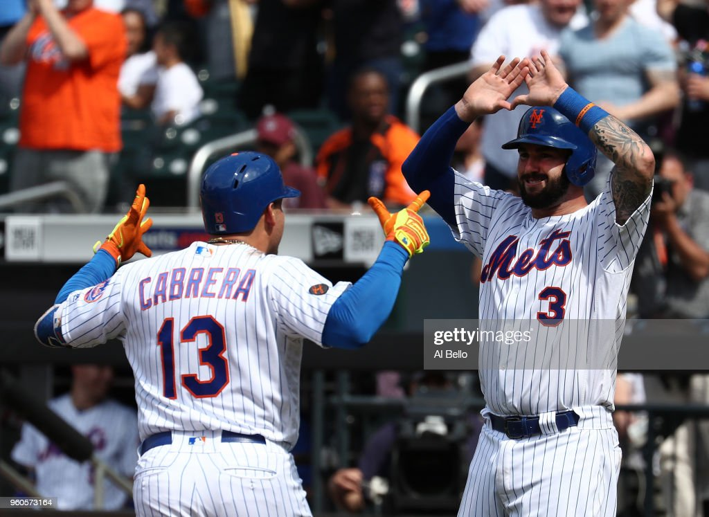 Asdrubal Cabrera #13 of the New York Mets celebrates with Tomas Nido #3 after hitting a two run home run against Jorge De La Rosa #29 of the Arizona Diamondbacks in the seventh inning during their game at Citi Field on May 20, 2018 in New York City.