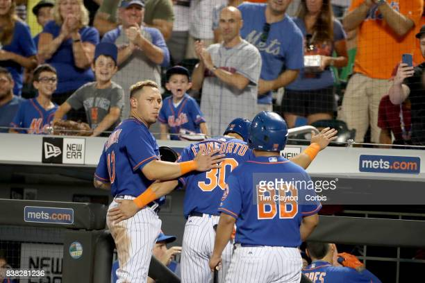 Asdrubal Cabrera of the New York Mets congratulates Michael Conforto of the New York Mets on a run scored during the Miami Marlins Vs New York Mets...