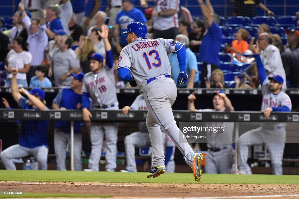 Asdrubal Cabrera #13 of the New York Mets hits a hoe run in the eighth inning against the Miami Marlins at Marlins Park on April 10, 2018 in Miami, Florida.
