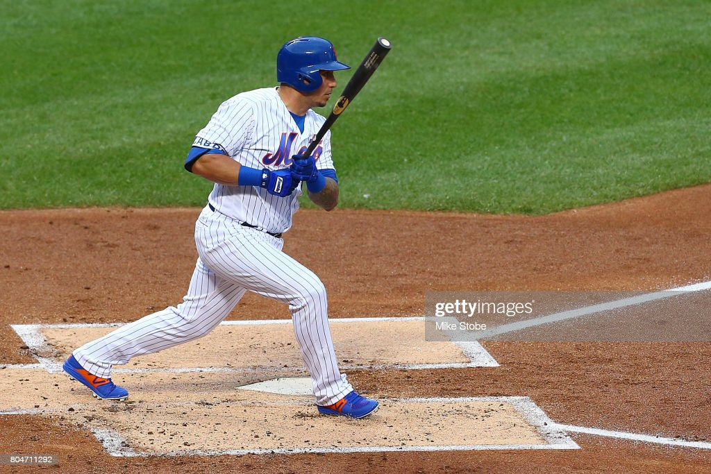 Asdrubal Cabrera #13 of the New York Mets hits a single in the first inning against the Philadelphia Phillies at Citi Field on June 30, 2017 in the Flushing neighborhood of the Queens borough of New York City.