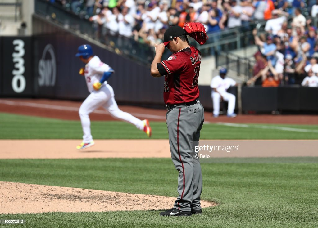 Asdrubal Cabrera #13 of the New York Mets hits a two run home run against Jorge De La Rosa #29 of the Arizona Diamondbacks in the seventh inning during their game at Citi Field on May 20, 2018 in New York City.
