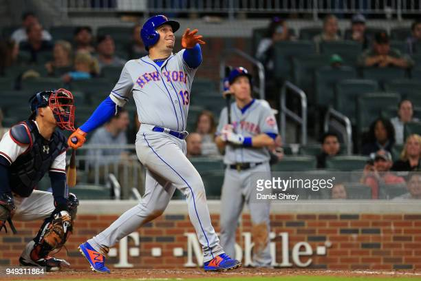 Asdrubal Cabrera of the New York Mets hits an RBI double during the twelfth inning against the Atlanta Braves at SunTrust Park on April 20 2018 in...
